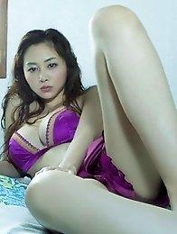 Anri Sugihara posing in purple lingerie her amazing big natural tits