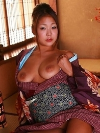 Asian babe showing her sexy body
