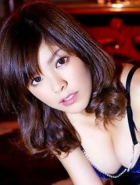 Milky skinned asian beauty in a one piece swim suit