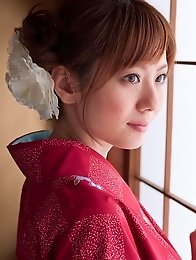 Yuna Asami wearing a beautiful traditional dress covering her big tits