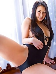 Thick asian hottie showing off her sexy body in a black swim suit