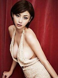 Anri Sugihara posing her super big breasts in a satin dress