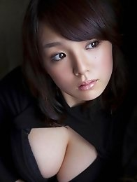 Busty asian Ai Shinozaki posing her sexy big breasts