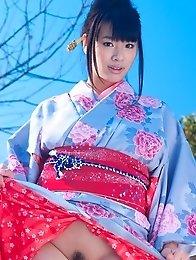 Asian big breasted Hana Haruna posing in a traditional japanese dress her huge tits!