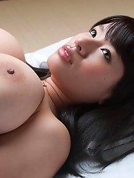 Busty asian Hana Haruna posing outside her natural big breasts!