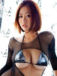 Japanese model Hitomi Kitamura posing her natural big tits in bikini