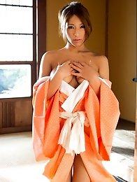 Lovely and tanned Japanese av idol Nami Hoshino shows her amazing naked body