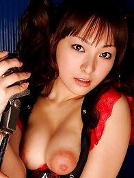 Kotono Asian in white bikini plays with her hard to resist boobs