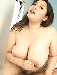 Yume Sazanami Asian rubs cock of her big jugs and sucks it well