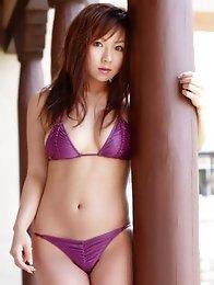Delectable grauvre idol beauty seduces in her purple bikini