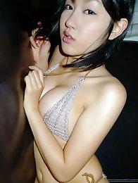Steamy gravure idol sizzles in her wet skimpy pink bikini