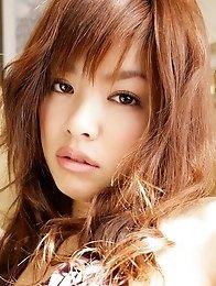 Barely clad Momoko Matsuzaki shows off her lickable curves