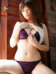 Busty asian babe with perfectly rounded tits in a purple bikini