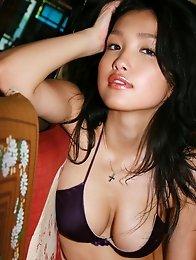 Luscious gravure idol posing with her big busty tits in a bikini