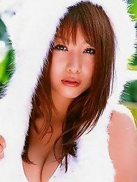 Busty gravure idol babe Mai Nishida looks delicious in her white bikini