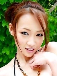 Busty Japanese girl loves posing