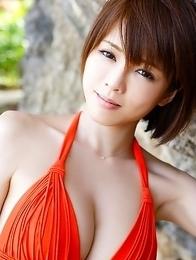 Japanese Yumiko Shaku  in orange bath suit takes a walk on the beach