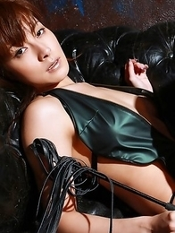 Rika Kawamura in boots shows naughty behind in nylon outfit