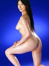 Saori Hara shows hairy pussy while fondling oiled boobies