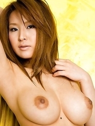 Reina Matsushima in colorful panties exposes big nude cans