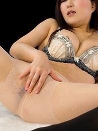Confident office girl Yuu Kazuki using her stockinged feet to jerk that big dick