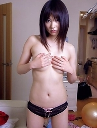 Akina Suzuki in panty takes bra off but hides her big jugs